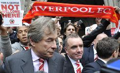 Liverpool chairman Martin Broughton, left, and commercial director Ian Ayre leave London's High Court as the Premier League club's ownership drama continued with a Friday debt deadline looming.