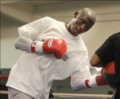 Antonio Tarver, left, makes his heavyweight debut Friday after 13 years as a light heavyweight.