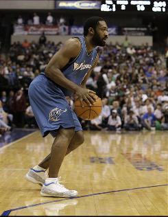 Gilbert Arenas, shown here during an Oct. 5 game against the Dallas Mavericks, faked an injury and didn't play in the Wizards' Tuesday night preseason contest.