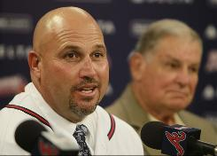 Fredi Gonzalez, left, speaks as former Atlanta Braves manager Bobby Cox looks on during Gonzalez's introductory news conference.