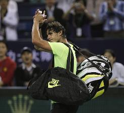 Rafael Nadal of Spain exits stage left after losing to Jurgen Melzer of Austria in the third round of the Shanghai Masters on Thursday. It's Nadal's first loss before the quarterfinals this season.