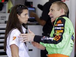 Danica Patrick, talking with Mark Martin during a practice session at Charlotte Motor Speedway on Wednesday, hopes to learn from the NASCAR veteran in order to succeed in the stock-car circuit.