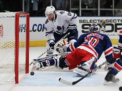 Phil Kessel couldn't get this shot past Rangers goalie Henrik Lundqvist but managed to get the game-winning overtime goal to propel the Maple Leafs to their best start since the 1993-94 season.