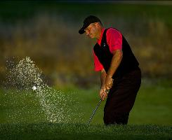 Rocco Mediate chips out of a bunker on the 11th hole during the second round of the Frys.com Open. Mediate will take will take a three-shot lead into Saturday's third round.