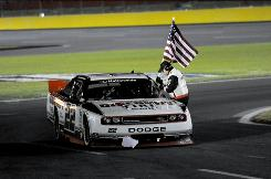 Brad Keselowski celebrates after winning the Dollar General 300 at Charlotte Motor Speedway.