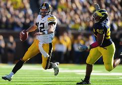 Iowa quarterback Ricky Stanzi had three touchdown passes to Derrell Johnson-Koulianos and the Hawkeyes beat Michigan.