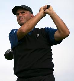Rocco Mediate watches his tee shot on the fourth hole during Saturday's third round of the Frys.com Open at the CordeValle Golf Club in San Martin, Calif. Mediate holds a three-shot lead after he fired a 4-under 67.
