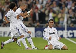 Real Madrid's Cristiano Ronaldo, right, celebrates his opening goal off of a free kick against AC Milan during their Group G Champions League match.