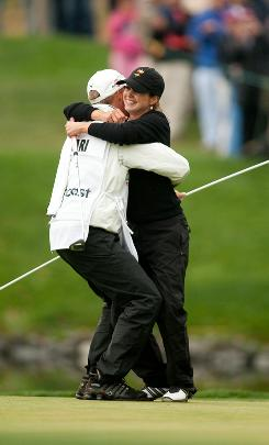 Beatriz Recari of Spain embraces caddie Andreas Thorp after winning the CVS/Pharmacy LPGA Challenge at the Blackhawk Country Club in Danville, Calif.