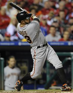 Giants' Cody Ross hits his fourth home run of the playoffs, third in the NLCS.