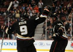Corey Perry, right, of the Anaheim Ducks celebrates his goal for a 3-2 lead over the Phoenix Coyotes with Bobby Ryan (9) during the third period at the Honda Center on Sunday in Anaheim, Calif.