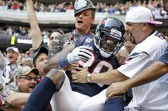 Texans WR Andre Johnson is mobbed by fans after he scored the go-ahead touchdown in the fourth quarter against the Chiefs.