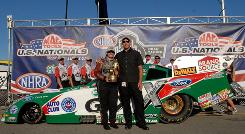 Ashley Force Hood is joined in the winner's circle at the U.S. Nationals by Scott Garwood, Legacy Coach.