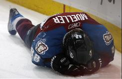 Hard hits, like the one taken by Avalanche center Peter Mueller last April, have become increasingly common and increasingly dangerous in today's NHL.