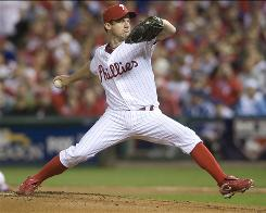 Roy Oswalt went eight innings, striking out nine and allowing three hits and one run, to help the Phillies even the NLCS against the Giants at one game apiece.