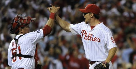 """Carlos Ruiz has to be the best in the game at putting fingers down,"" reliever Brad Lidge says of his catcher's signal calling. Says Ruiz, ""I can tell any pitcher we need to throw this pitch in any situation and they're OK."""