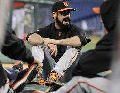 """I have a lot of anger in me,"" says Giants closer Brian Wilson, warming up with teammates before Game 2 of the NLCS. ""I use that anger when I pitch."""
