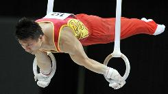 China's Yibing Chen competes on the rings in the men's qualifying session at the world championships, on Oct.19.