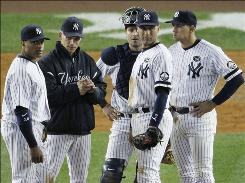 Yankees manager Joe Girardi, second from left, makes a pitching change Tuesday in the seventh inning, when the Rangers scored twice to take a 7-3 lead en route to their 10-3 victory in Game 4.