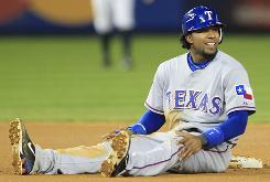 The Rangers' Elvis Andrus sits at second base after getting picked off by Yankees relief pitcher Kerry Wood in the seventh inning Wednesday.