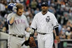 Pitcher CC Sabathia, right, heading back to the Yankees dugout after retiring the Rangers' Josh Hamilton, came through Wednesday.