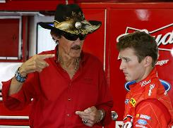 In this June file photo, Sprint Cup driver Kasey Kahne, right, receives instructions from NASCAR legend Richard Petty, owner of Richard Petty Motorsports. Kahne was released from Richard Petty Motorsports Wednesday night.