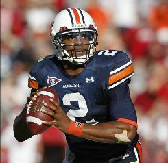 Quarterback Cam Newton has taken a liking to Auburn's offense. He will lead the Tigers against LSU on Saturday.