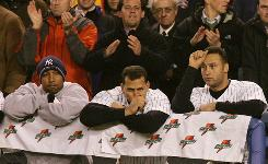 Enrique Wilson, left, Alex Rodriguez and Derek Jeter watch the Red Sox win Game 6, then go on to win Game 7 of the 2004 ALCS, in which the Yankees became the only team to lose a 3-0 series lead.