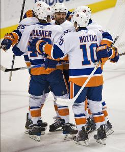 The New York Islanders, celebrating Michael Grabner's first-period goal against the Lightning, improved to 4-1-2 on the season.