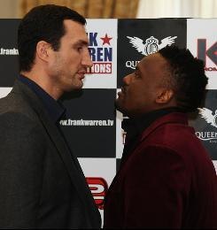Wladimir Klitschko of Ukraine looks eye to eye to Derek Chisora of Great Britain during a press conference for their Dec. 11 fight.