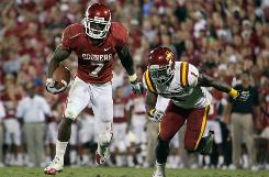 Oklahoma running back DeMarco Murray, rushing past Iowa State's David Sims for a touchdown on Oct. 16, is eighth all-time in the Sooners' record books with 3,134 rushing yards.