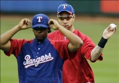Rangers left fielder Josh Hamilton and shortstop Elvis Andrus get loose during the team's workout Thursday in preparation for Friday's Game 6 against the Yankees.