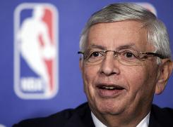 NBA commissioner David Stern responds to a question during a news conference on Thursday in New York. Stern said the league would like to cut players' salary costs by nearly 35%.