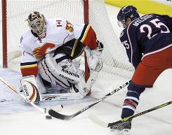 Flames goalie Henrik Karlsson, Making a save on the Blue Jackets' Kyle Wilson during the third period, won his NHL debut with 20 saves.