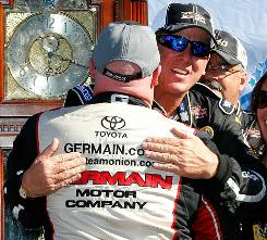 Ron Hornaday gets a hug from third-place finisher Todd Bodine after his truck series triumph at Martinsville Speedway.