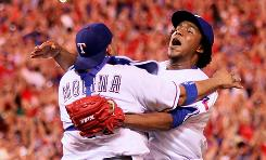 Bengie Molina, left, and Neftali Feliz of the Texas Rangers celebrate after defeating the New York Yankees 6-1 in Game 6.