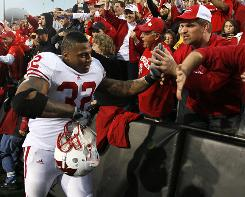 Wisconsin running back John Clay celebrates with fans after his team's 31-30 defeat of Iowa.