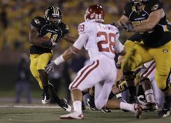 Missouri running back Henry Josey runs during the first quarter of the Tigers' upset over Oklahoma. Missouri ended a seven-game losing streak to the Sooners.