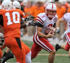 Nebraska quarterback Taylor Martinez outran the Oklahoma State defense on this play, but his five touchdown passes helped the Cornhuskers knock off the unbeaten Cowboys.