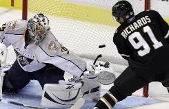 Predators goalie Pekka Rinne blocks a shot by Stars center Brad Richards during the second period.