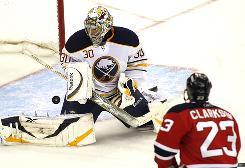 Buffalo Sabres goalie Ryan Miller blocks a goal attempt by New Jersey Devils' David Clarkson during the second period Saturday.