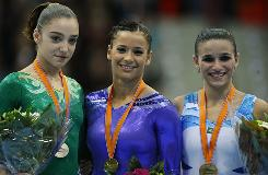 Alicia Sacramone, flanked by Russia's Aliya Mustafina, left, and Brazil's Jade Fernandes Barbosa, successfully came back from retirement with a gold medal in the vault at the world championships.