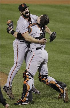 Giants closer Brian Wilson, left, celebrates with catcher Buster Posey after striking out the Phillies Ryan Howard to end Game 6 and propel San Francisco to the World Series.