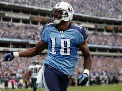 Titans wide receiver Kenny Britt celebrates his 16-yard touchdown catch during the fourth quarter against the Eagles. Britt entered the game in the second quarter and finished with 225 yards receiving and three scores.