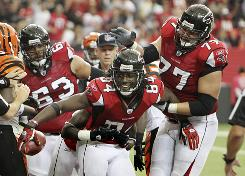 Roddy White and the Falcons improved to an NFC South-best 5-2 on Sunday.