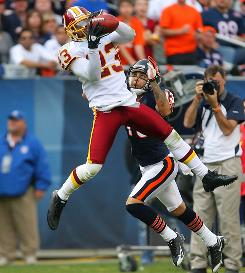 Redskins cornerback DeAngelo Hall intercepts a pass intended for Bears receiver Johnny Knox during the second half. Hall returned the pick, one of four he had Sunday, 92 yards for a touchdown.