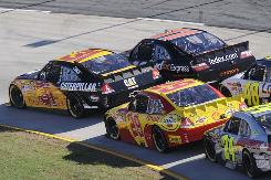 Teammates Jeff Burton (31) and Kevin Harvick (29) battle in close quarters alongside eventual race winner Denny Hamlin (11) while Jimmie Johnson (48) and Jeff Gordon follow in hot pursuit at Martinsville Speedway.