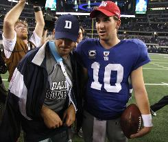 Dallas Cowboys quarterback Tony Romo Romo, left, broke his left collarbone in the second quarter, then his teammates let a 13-point lead turn into a 41-35 loss to Eli Manning, right, and the Giants.