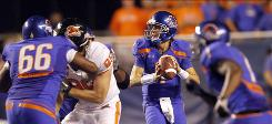 Led by Kellen Moore, right, Boise State could end up No. 2 in the polls but get locked out of the BCS title game.
