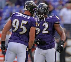 Jarrett Johnson, Ray Lewis and the Ravens improved to 5-2 with an overtime win against the Bills on Sunday.